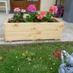 Menuisier - Fabrication de jardinières en pin